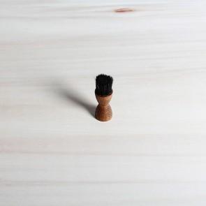 Small round applicator brush, dark or light